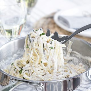 A delicious twist to your everyday fettuccine Alfredo! This Salmon Fettuccine is extraordinarily flavorful and can be made within 20 minutes. Recipe at livelaughrowe.com