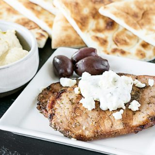 These greek pork chops are packed with flavor and are easy enough for a last-minute dinner! Serve with your favorite greek toppings and greek pita bread. livelaughrowe.com