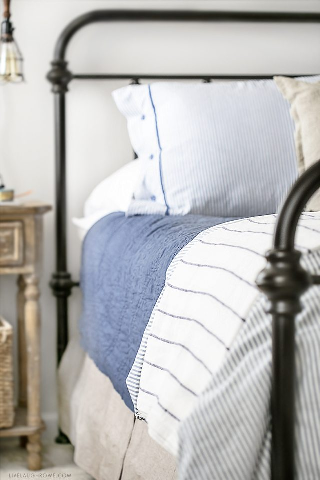 Farmhouse Inspired Master Bedroom Makeover. Perfectly light, bright and so many beautiful pieces. See all the details at livelaughrowe.com