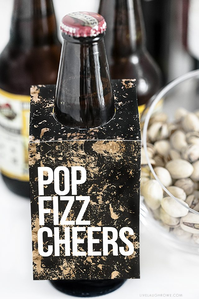 Pop Fizz Cheers! Whether it's for a birthday celebration, engagement party or New Years Eve -- these printable bottle tags are sure to bring a little extra fun to the party! livelaughrowe.com