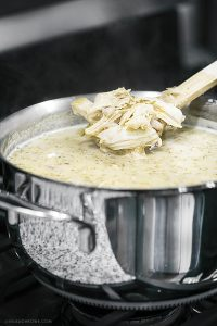 Stirring White Chicken Chili being prepared in the Lagostina Opera Cookware. Recipe at livelaughrowe.com