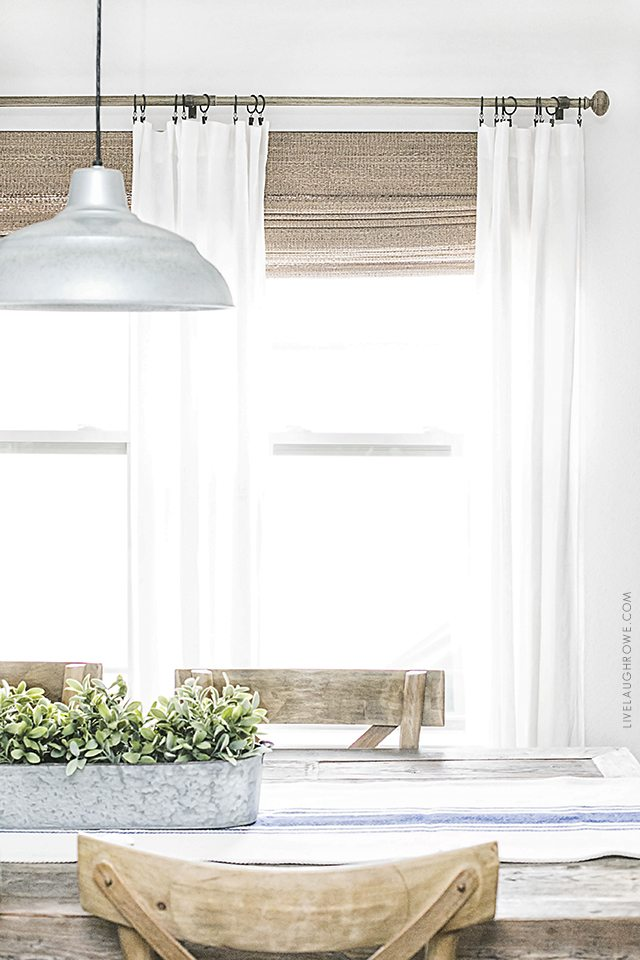 Beautiful neutral window treatments with farmhouse flare! From Levolor Natural shades to linen curtains, the space is bright and inviting. Learn more at livelaughrowe.com