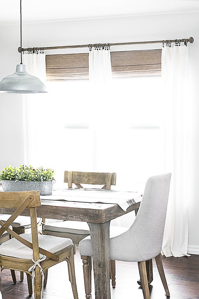Beautiful neutral window treatments with farmhouse flare! From LEVOLOR® Natural shades to linen curtains, the space is bright and inviting. Learn more at livelaughrowe.com