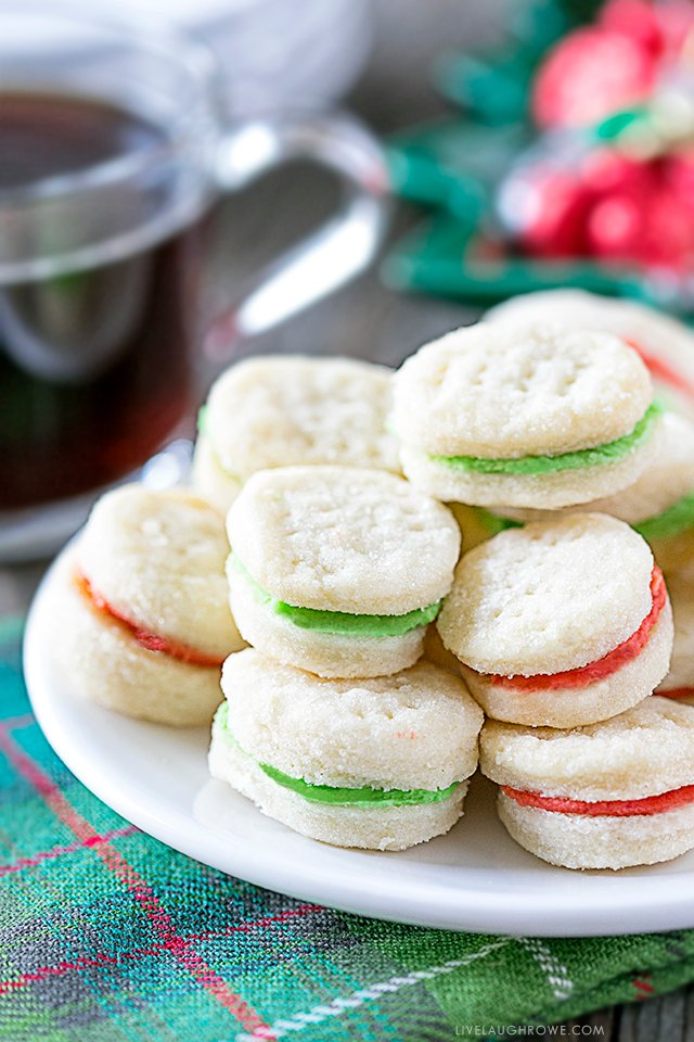 Meet your new favorite cookie! This Cream Wafer Cookie Recipe is packed with sweet, buttery crunchy goodness. Make the frosting with different colors for holidays and special events... like these for green and red Cream Wafer Cookies for Christmas. Recipe at livelaughrowe.com