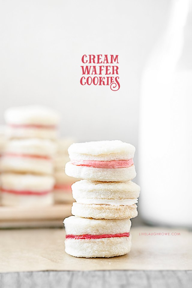 Meet your new favorite cookie! This Cream Wafer Cookie Recipe is packed with sweet, buttery crunchy goodness. Make the frosting with different colors for holidays and special events... like these with pink filling for a fun Valentine's Day dessert. Recipe at livelaughrowe.com