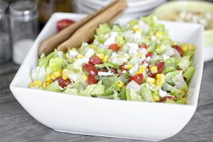 Simple chopped salad recipe packed with color and flavor. Pair with a delicious soup or sandwich for lunch or dinner. Learn more at livelaughrowe.com