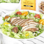 Zesty Pecan-Crusted Chicken and Grapes on Salad Greens
