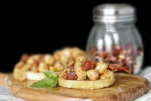 Savory Chickpea Crostini with Sun-Dried Tomatoes