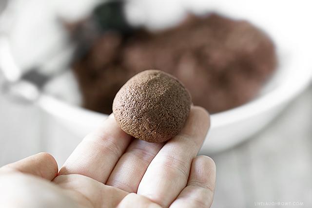 Rolling cinnamon applesauce into a ball