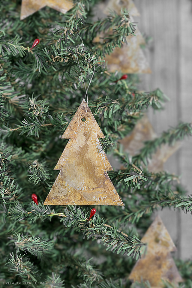 DIY Rusty Metal Ornaments. If you love the rusty, chippy look -- these ornaments will be a perfect addition to your Christmas decor (and tree)! Full tutorial at livelaughrowe.com