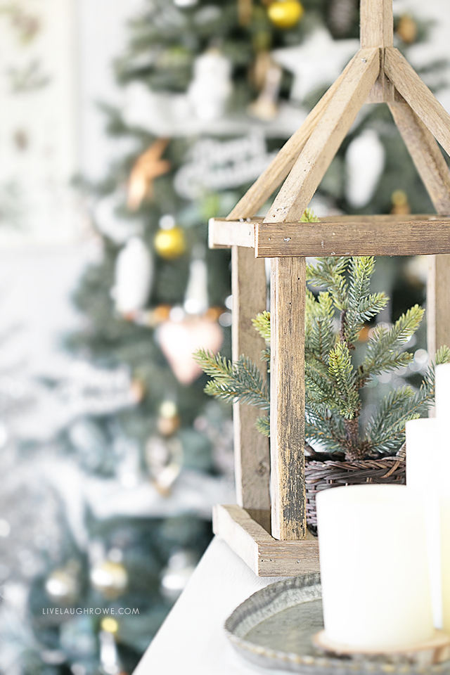 This pallet wood framed lantern is BEAUTIFUL! Silver and Gold Christmas Tree is lovely too. livelaughrowe.com