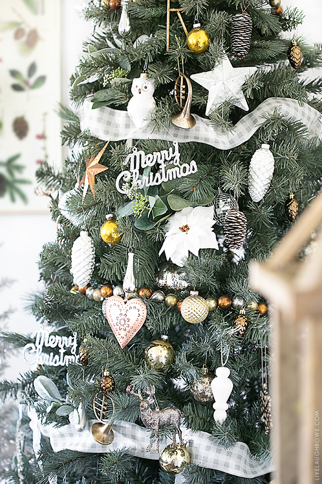 Beautiful Silver and Gold Christmas Tree . So many great ideas and the red accents in the wrapping paper and decor is lovely. livelaughrowe.com