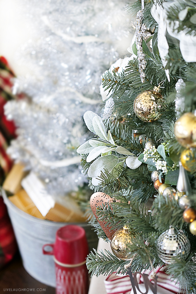 Beautiful Silver and Gold Christmas Tree. Love seeing the old pieces paired with some new, shiny pieces. livelaughrowe.com