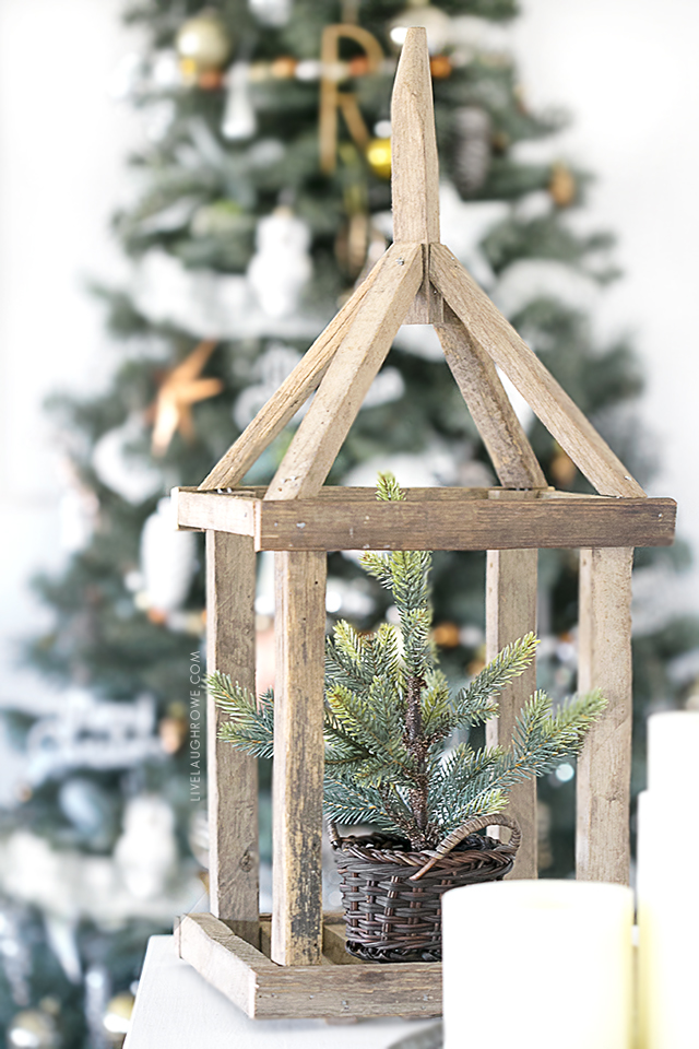 AWESOME wooden framed lantern! So many beautiful Christmas decor ideas. Lovely Silver and Gold Christmas tree too. livelaughrowe.com