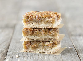 These AMAZING Pecan Pie Bars are not only a delicious dessert bar, but they're also a great crowd pleaser. Flaky shortbread crust with an incredible pecan pie filling will make these a new favorite. Recipe at livelaughrowe.com #pecanpie #dessertbar