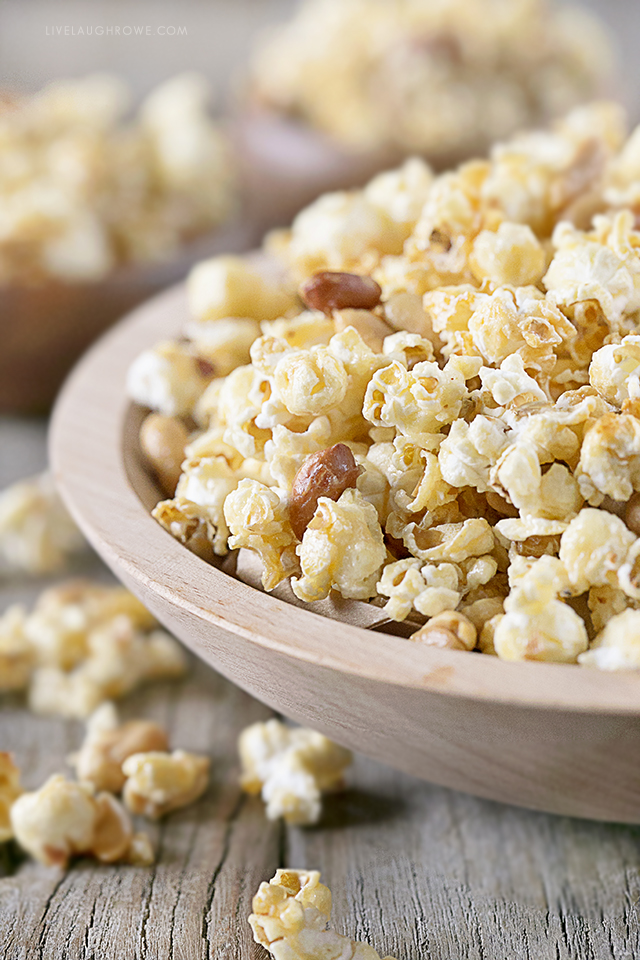 This homemade popcorn recipe is the bomb-diggity! If you enjoy a sweet and salty popcorn treat, then this might just be a new favorite. Did I mention it's super easy to make too?!? Recipe at livelaughrowe.com #sweetandsalty #popcornrecipe #snack #peanuts