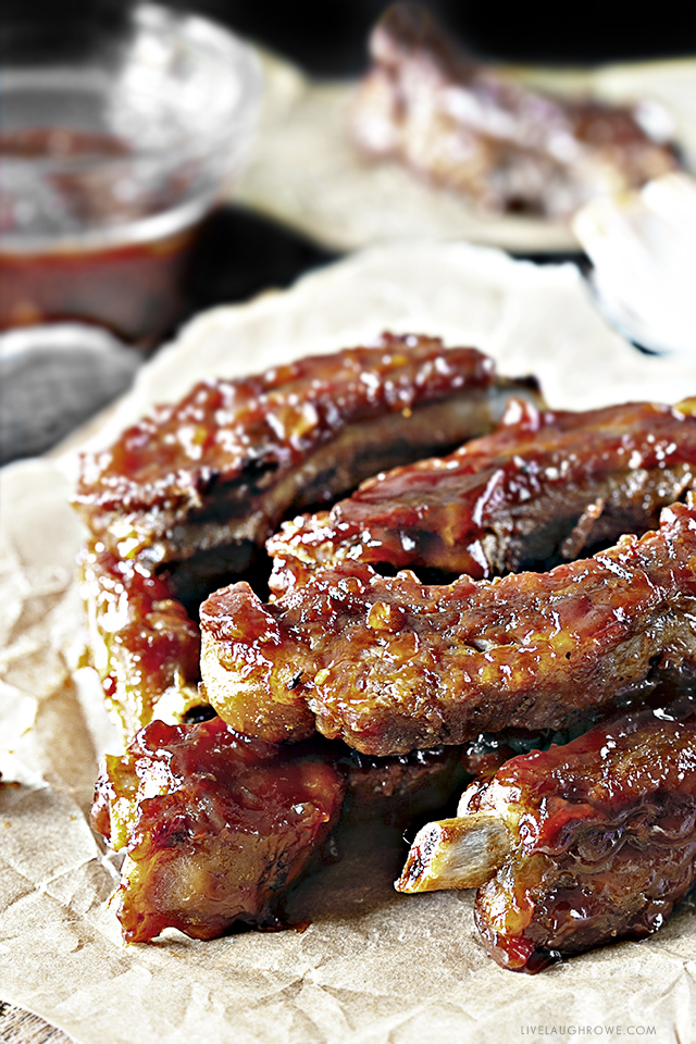 Forget the hamburgs and hot dogs, these Sweet BBQ Oven Baked Baby Back Ribs are sure to be the star of the show! Baking them in the oven keeps them simple — and the sauce is perfection. Recipe at livelaughrowe.com
