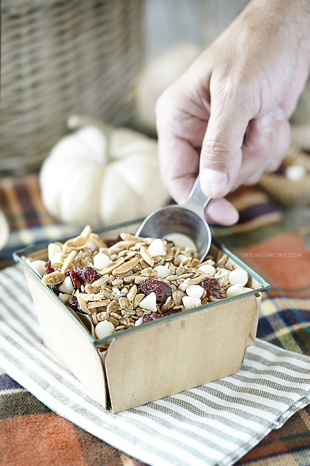 Scooping granola from container