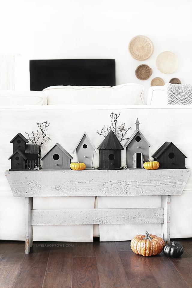 Halloween Birdhouses on a Gray Bench