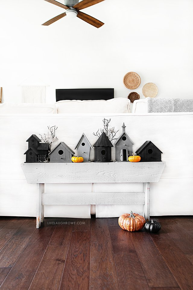 Black and Gray Birdhouses on a Bench