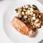 Plated Salmon with Cream Sauce and Vegetables