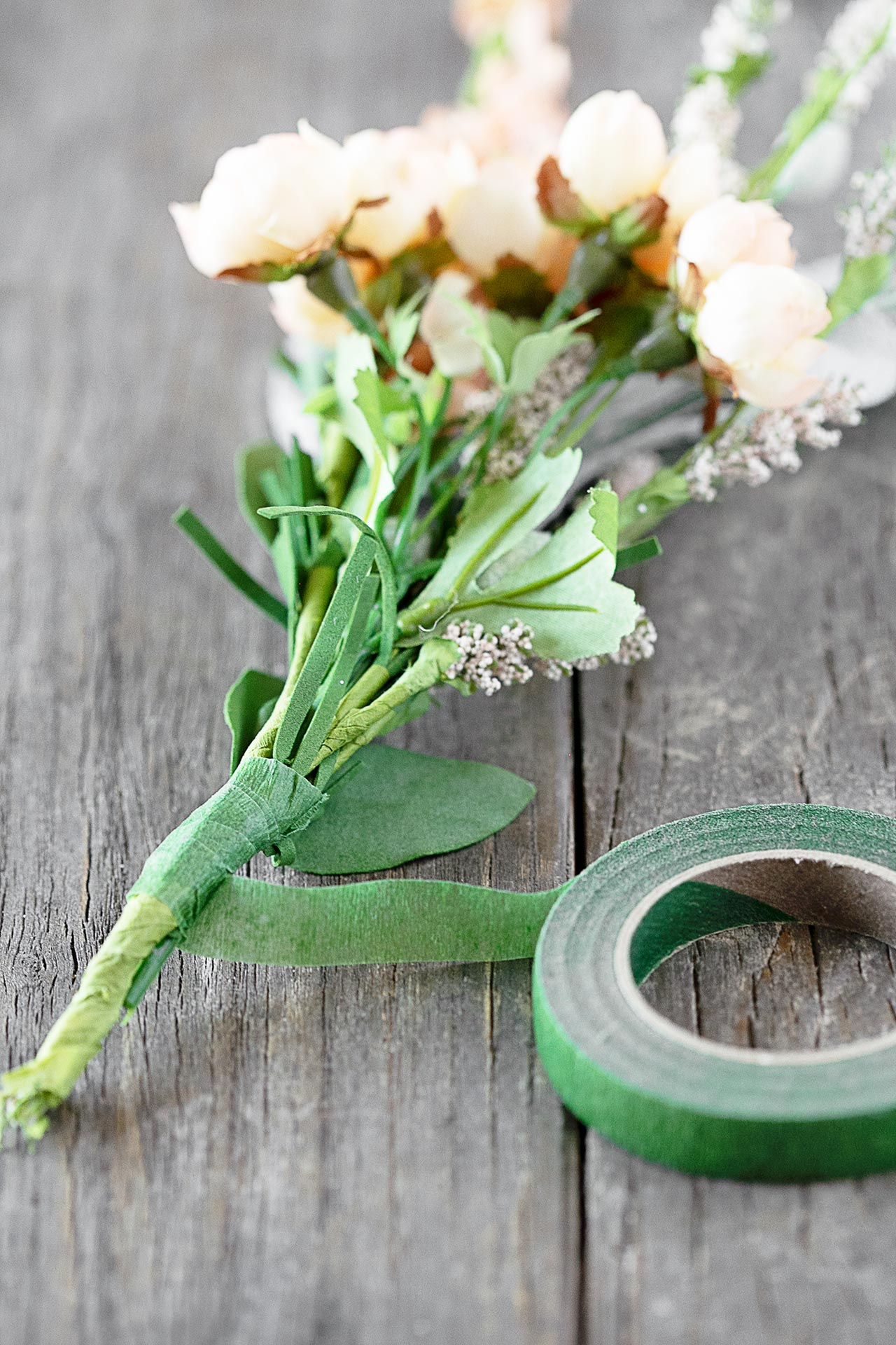 Wrapping Floral Stems Together with Floral Tape
